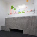 Kinderbadkamer voor minder valide
